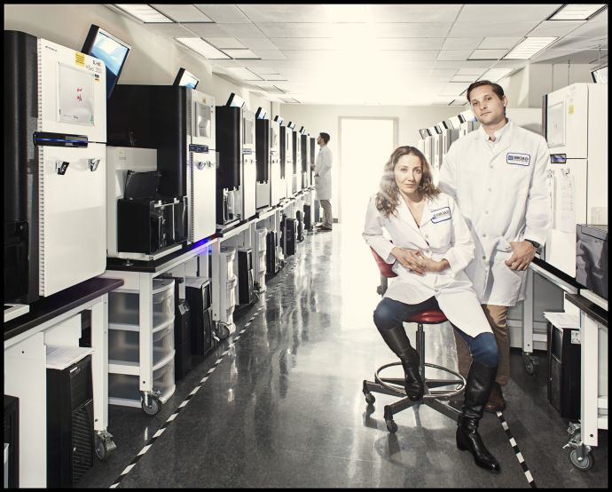Pardis Sabeti and Stephen Gire in the Genomics Platform of the Broad Institute of M.I.T. and Harvard, in Cambridge, Massachusetts. They have been working to sequence Ebola's genome and track its mutations. Credit Photograph by Dan Winters