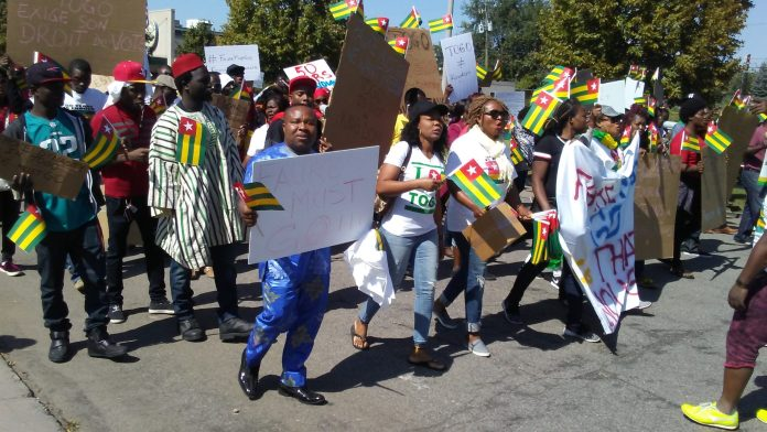 Togolese take to the Capitol. Photo: The AfricaPaper/James K. Fasuekoi