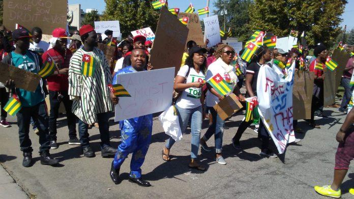 Togolese take to the Capitol. Photo: The AfricaPaper/James K. Fasuekoi