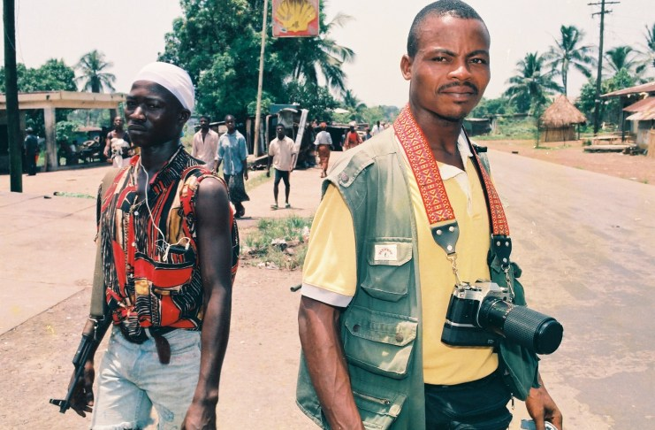Award-winning journalist/former war correspondent, James Kokulo Fasuekoi is seen in this undated photograph in the Liberian highway town of Kakata, where the Booker T. Washington Institute, BWI (a vocational center is located), after a gun battle between Taylor's forces and fighters of Roosevelt Johnson's ULIMO-J. Photo: Alex