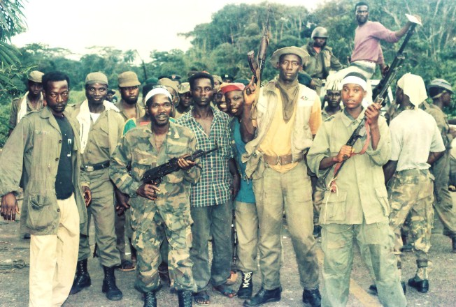 A mix of Mandingo-Krahn ULIMO rebel soldiers posed for a photo at their Po River guard post near Combat Camp. Photo: James K. Fasuekoi/The AfricaPaper