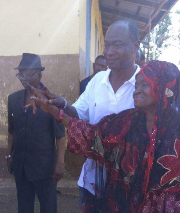 Dr. Samura Kamara and mother after voting in his village, Kamalo. Photo Abubakarr Kamara/The AfricaPaper