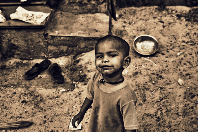 Photo © Samir PIllai | Deprived of basic rights of food, home, clothing and education, yet manages to smile
