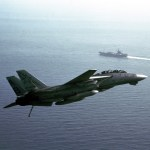 A Fighter Squadron 33 (VF-33) F-14A Tomcat aircraft banks into a turn as it heads for a landing aboard the aircraft carrier USS AMERICA (CV 66) during Operation Desert Shield. (US Navy Photo)