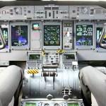 The glass cockpit flight deck of a Q400 variant