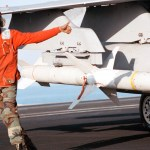 """Aviation Ordnanceman 3rd Class Quentin Bryant, from Augusta, GA, gives a """"thumbs up"""" following the inspection of an AGM-88 """"HARM"""" air-to-ground high speed missile, loaded on an F/A-18C """"Hornet."""""""
