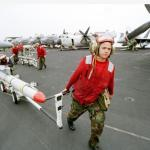 """An AGM-88 """"HARM"""" being moved on the USS Carl Vinson"""