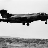 A Hawker Siddeley Buccaneer S.2B of No. 12 Squadron, Royal Air Force, performing a touch and go landing at the U.S. Navy Naval Weapons Center at China Lake, California (USA), during an air show of USN test and evaluation squadron VX-5 on 16 September 1981.