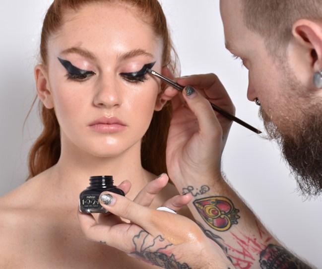MUA Tony Tulve creating an extreme winged eyeliner.