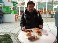 Eating curry wurst and freis for a quick lunch in the freezing cold.