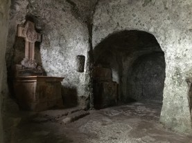 Inside the cliff catacombs at St. Peter's Cemetery