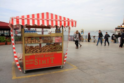 A stand selling simit, donut shaped bread covered in sesame seeds