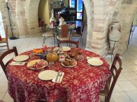Breakfast (croissants, pastries, ham and cheese, eggs, fruit) at our Ortona hotel