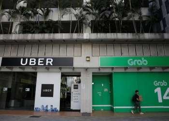 Grab เข้าซื้อกิจการ Uber ในเอเชียตะวันออกเฉียงใต้