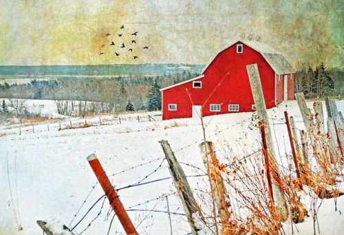 A red barn in the snow
