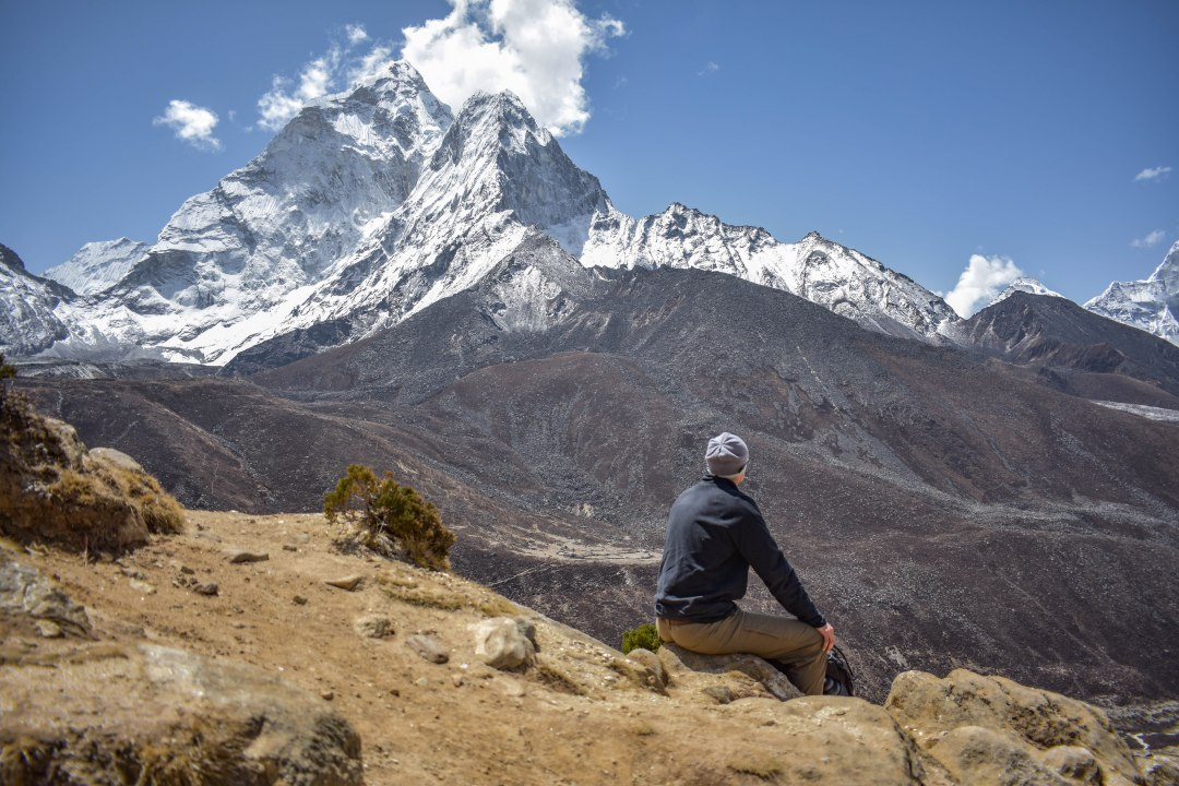 Sitting above Dingboche, Nepal at 14,469 ft. The effects of high altitude can be felt at this elevation, including headaches, nausea, and insomnia.
