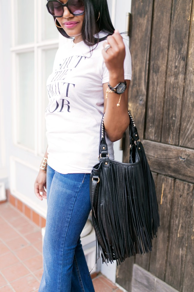 graphic tee and flare jeans, graphic tee, t and j designs, shut the front dior, casual outfit, graphic tee outfit, how to wear flares, dallas blogger, fashion blogger, black fashion blogger, fringe handbag
