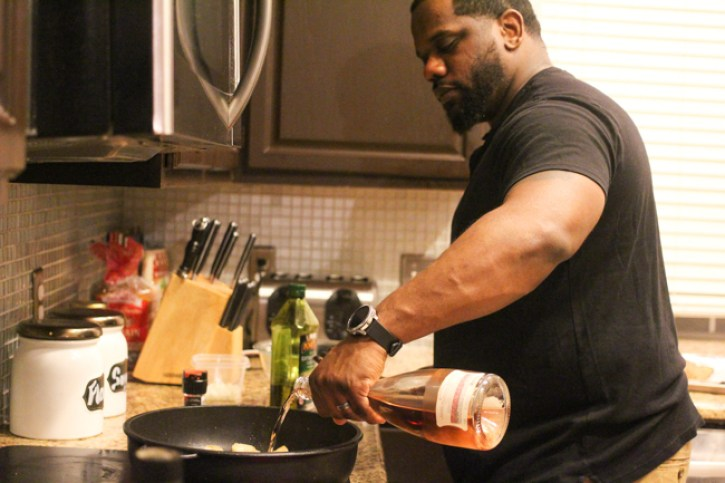 date night at home, black love, couple cooking together