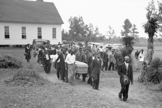 A funeral procession in Monroe, Georgia, for George Dorsey and Dorothey Dorsey Malcolm, who were lynched in 1946.