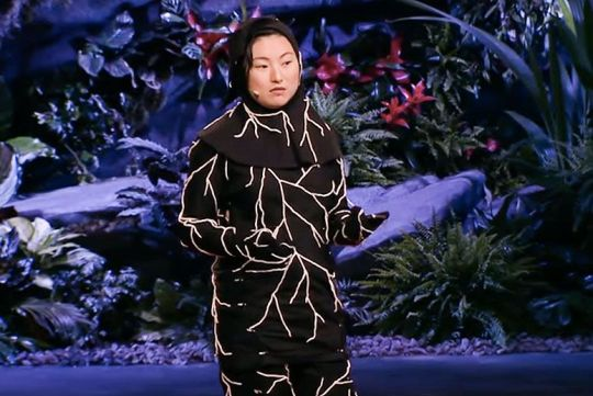 Jae Rhim Lee doing a TED Talk in her mushroom burial suit.