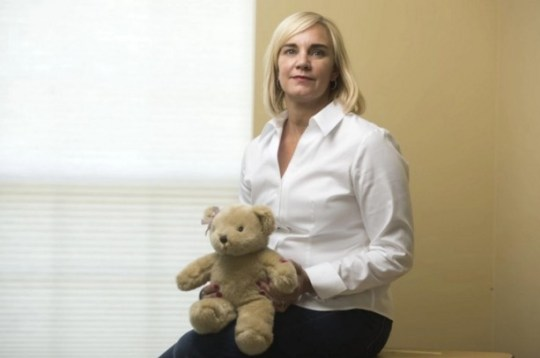 Cathleen Warner holds the teddy bear that has the recorded heartbeat of her daughter, Erin, who lived just 27 minutes.