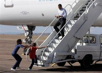 Barack Obama back from a campaign stop.