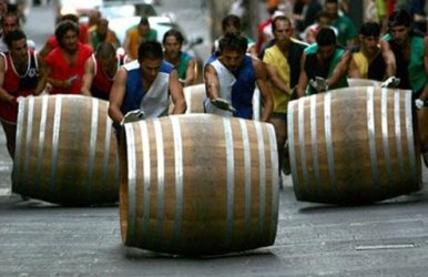 Rolling giant barrels a mile uphill.