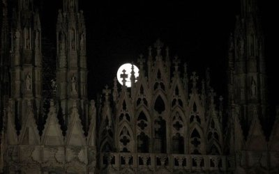 Moonrise over the Milan Duomo.