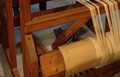 Looms were early examples of sophisticated mechanics.