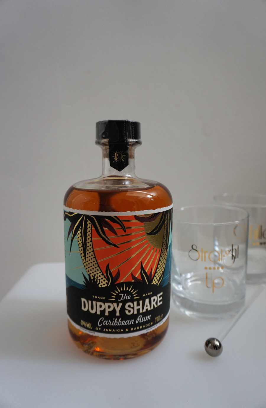 food and drink gift guide Duppy Share Caribbean Rum A bottle of it with two glasses