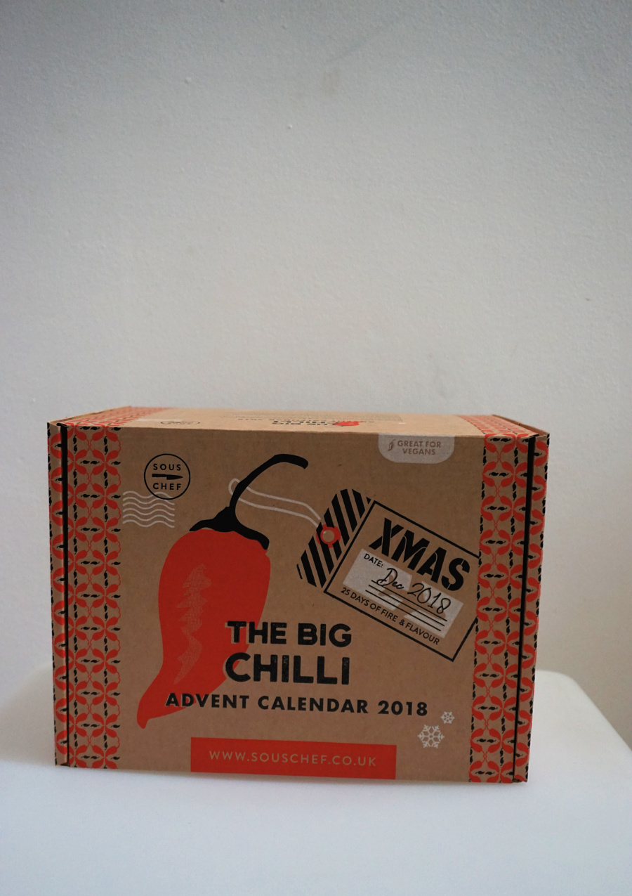 food and drink gift guide a chiili advent calendar - a cardbord box filled with chillis and recipes