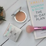 powder makeup with brush flatlay