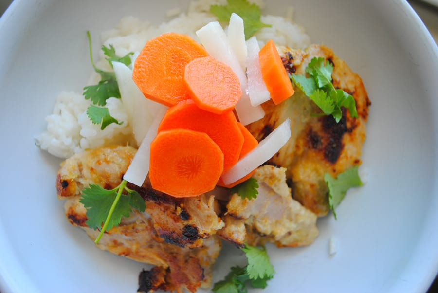 Lemongrass Chicken with Pickled Vegetables over rice.