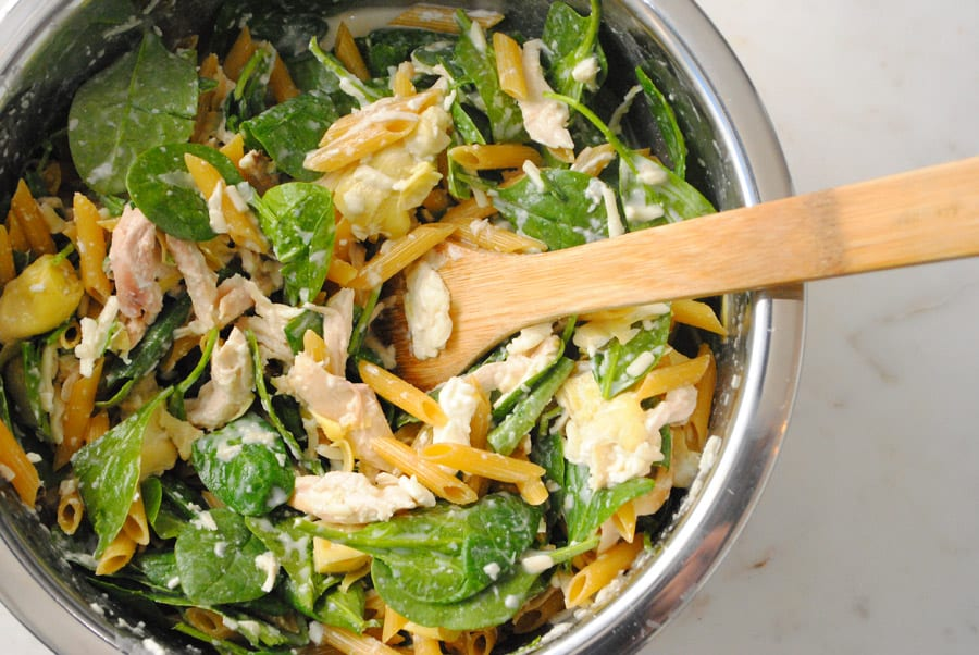 No Boil Spinach Artichoke Penne gets all mixed up in a bowl before baking.