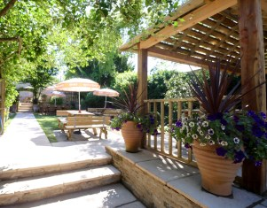 Our beautiful walled garden with gazebo for more sheltered alfresco dining