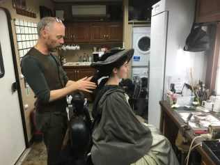 Richard finishes my look off with the hat. 18th Century Me!