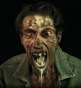 Creepy walking dead rotten and drooling is looking to you hungrily.