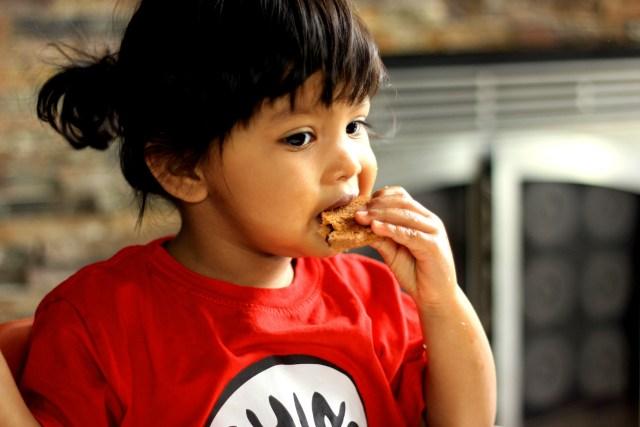 Asha eating homemade cookies