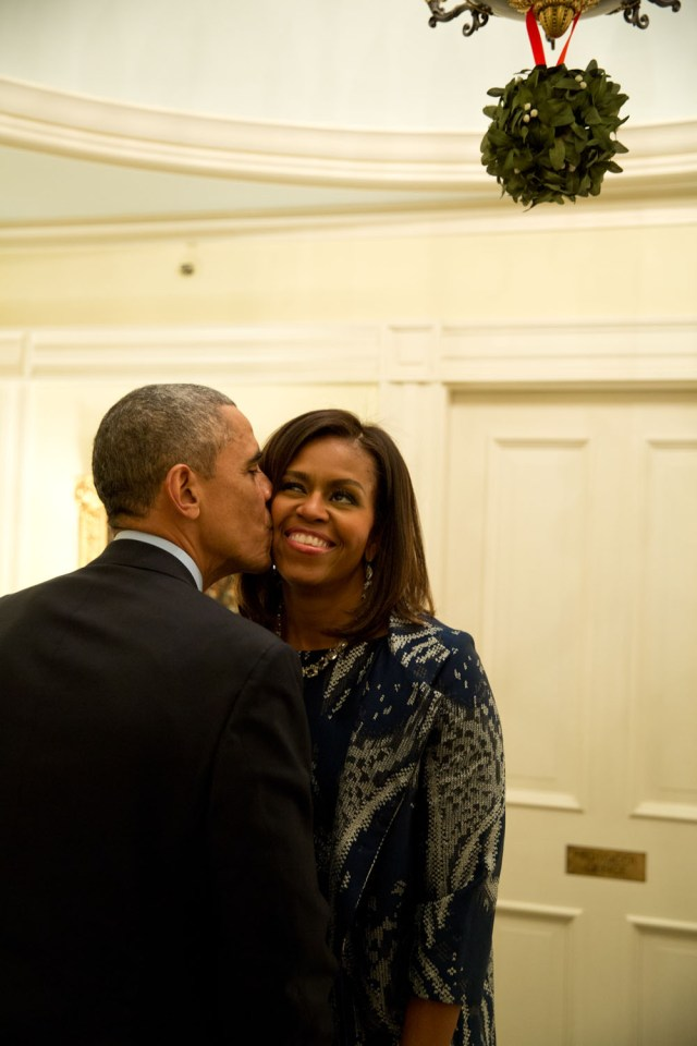 "Dec. 3, 2014 ""The First Lady and I both spotted the President standing under the mistletoe and she moved in to grab a kiss from him following a dinner for Combatant Commanders and military leadership at Blair House in Washington, D.C."" (Official White House Photo by Pete Souza) This official White House photograph is being made available only for publication by news organizations and/or for personal use printing by the subject(s) of the photograph. The photograph may not be manipulated in any way and may not be used in commercial or political materials, advertisements, emails, products, promotions that in any way suggests approval or endorsement of the President, the First Family, or the White House."