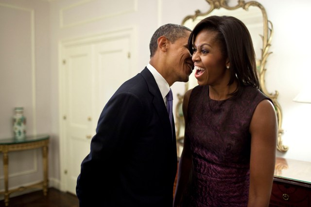 "Sept. 21, 2011 ""The First Lady reacts to something the President whispered to her at the Waldorf Astoria Hotel in between events related to the United Nations General Assembly in New York City."" (Official White House Photo by Pete Souza) This official White House photograph is being made available only for publication by news organizations and/or for personal use printing by the subject(s) of the photograph. The photograph may not be manipulated in any way and may not be used in commercial or political materials, advertisements, emails, products, promotions that in any way suggests approval or endorsement of the President, the First Family, or the White House."
