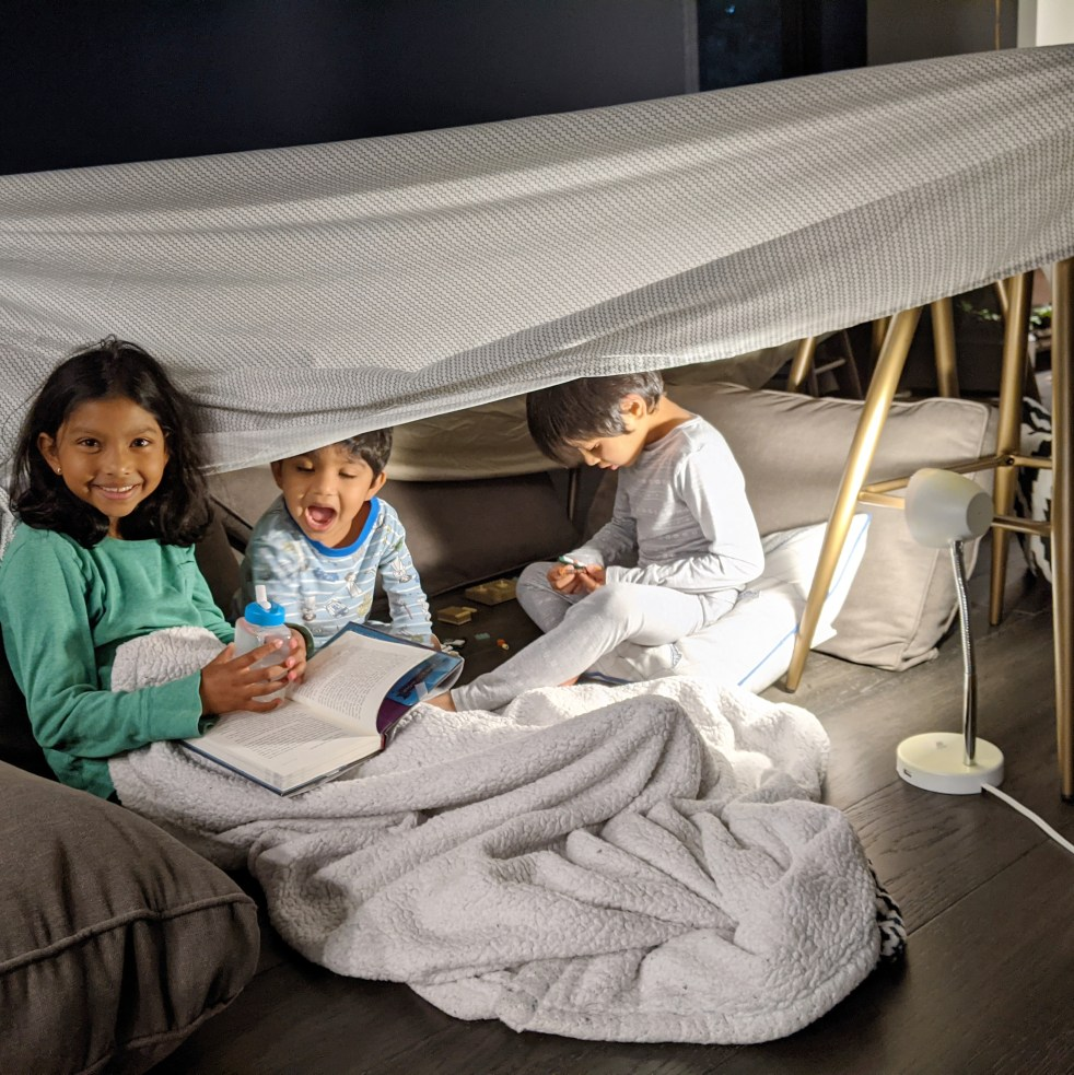 kids reading in a play fort