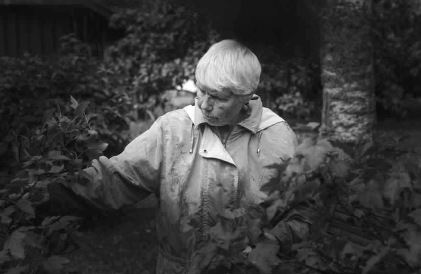 monochrome photo of woman near plants