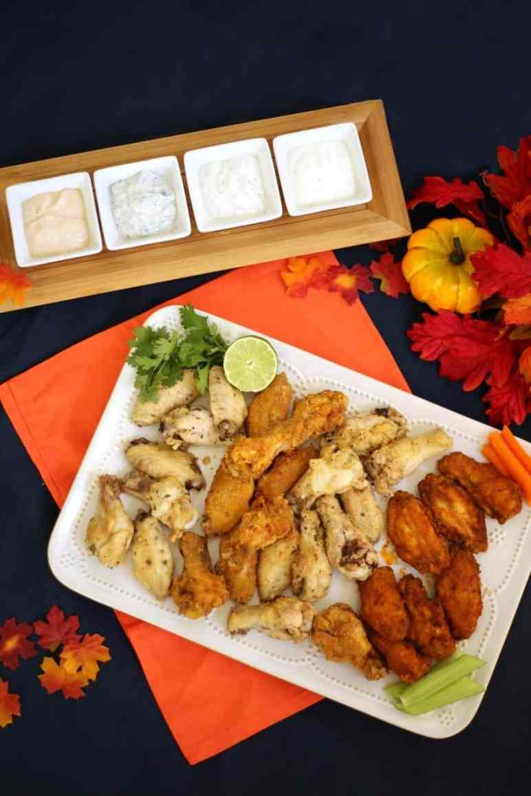 Chicken wings 4 ways: Buffalo, Indian curry, cilantro lime, and parmesan garlic. The perfect football food! #Tailgreatness (AD)