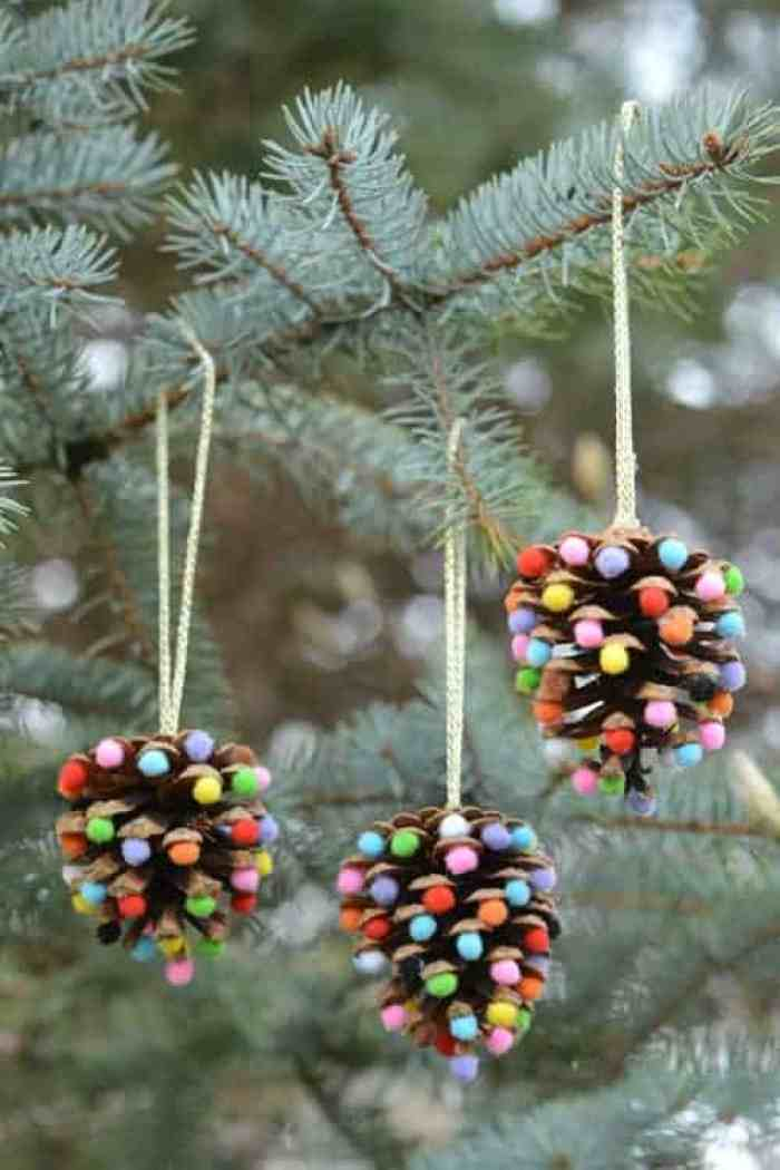 Christmas Pine Cone Crafts for Kids and Adults - pinecone pom-pom ornament #christmas #crafts #diy #pinecones #holidays #xmas #christmascrafts