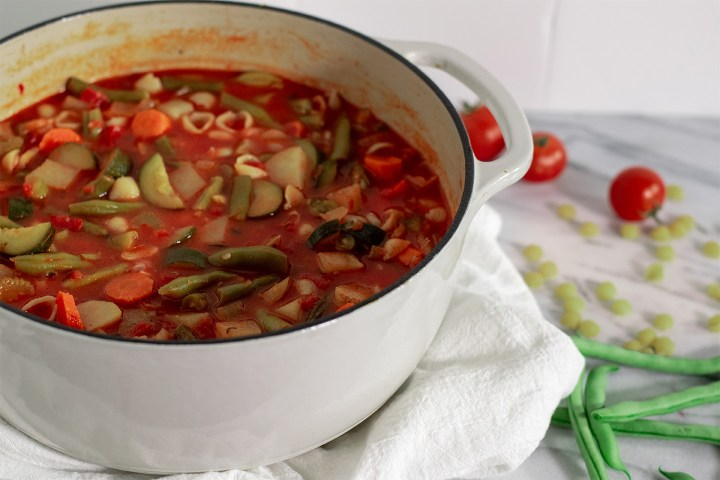 Minestrone soup with zucchini and green beans summer vegetables from the garden