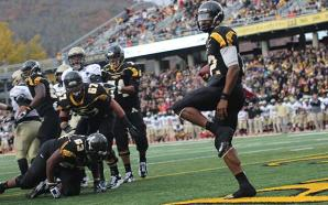 Quarterback Jamal Londry-Jackson looks at the crowd after breaking through the Terrier defensive line to run the ball in for a touchdown against Wofford in 2012. The Mountaineers lost the game, 38-28. Photo by Paul Heckert | The Appalachian
