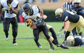 Freshman running back Marcus Cox plows through the defense during Saturday's game against Wofford. The Mountaineers sailed past the Terriers for a 33-21 win. Photo courtesy of Keith Cline