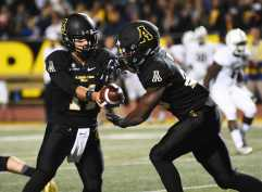 Quarterback Taylor Lamb hands the ball off during Thursday's game against Georgia Southern. The Mountaineers defeated the Eagles 31-13, handing them their first conference loss since joining the Sun Belt.