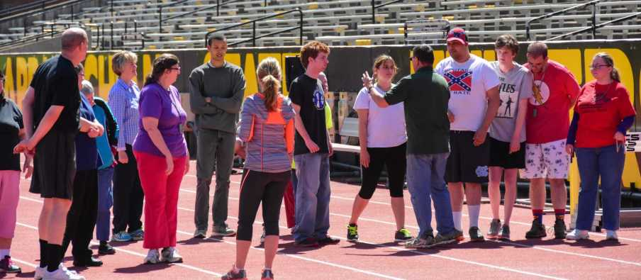 Keron Poteat instructs the Olympians in properly doing the walking and running races. Photo by Lee Sanderlin.