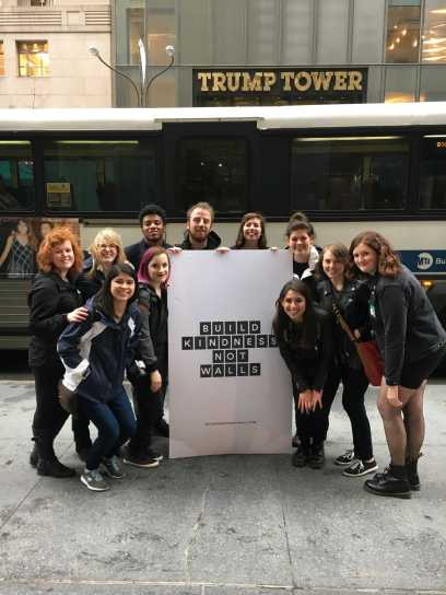 "Appalachian State University students hold up a sign that reads ""build kindness not walls,"" in front of Trump Tower in New York City. Photo courtesy Rachel Bowles."